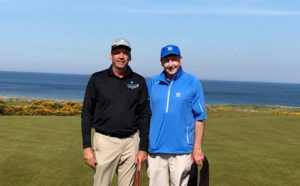 David Clement with caddie Denis on the 18th green at Kingsbarns Golf Links, St. Andrews, Scotland